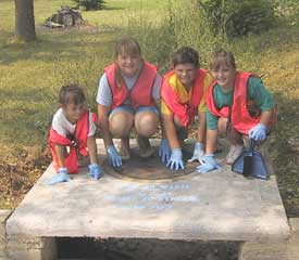 Girl Scouts stenciling storm drains in West Plains. Photo from the Bryant Creek Watershed Project.