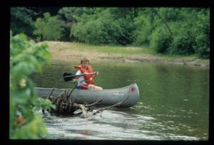 Canoeing on the Huzzah River. Photo from the Missouri Division of Tourism Archives, Missouri State Archives.